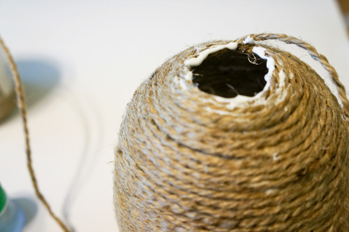 Glue the next layer of twine on top