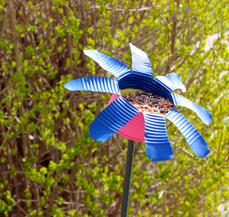 Make a bird feeder for your yard from recycled materials at ThinkCrafts.com