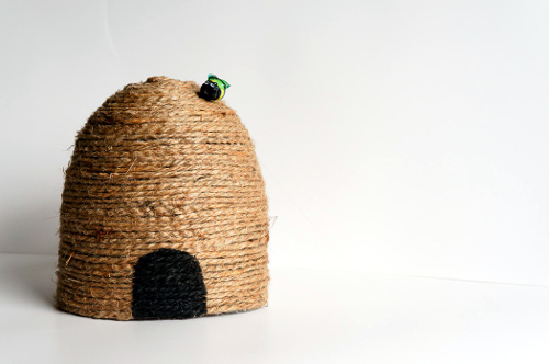 Use a soda bottle to create a dome shaped bee skep decoration - ThinkCrafts.com
