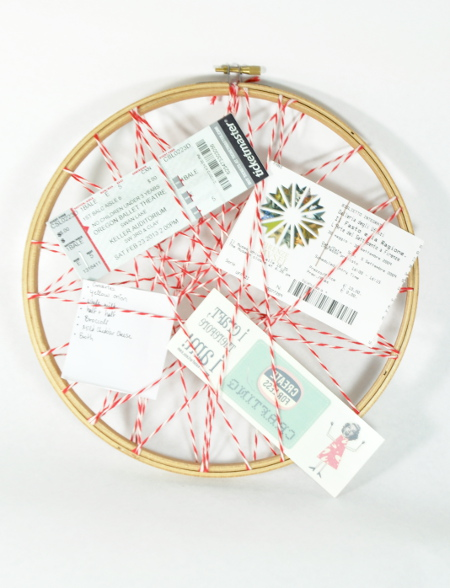 DIY a memo board from an embroidery hoop and string. Tutorial at ThinkCrafts.com