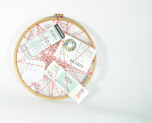 Make a cute memo board from an embroidery hoop and string. Tutorial at ThinkCrafts.com