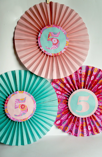 Fold up these paper fans for easy and fun birthday decor!