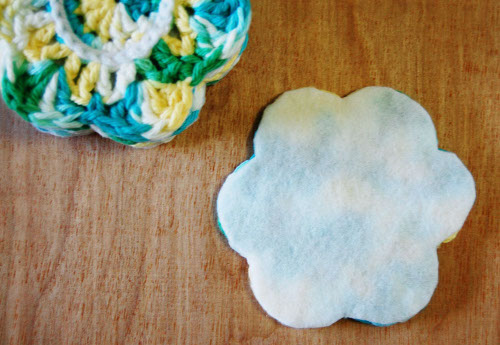 Add felt to the back of crochet coasters for a sturdier, more polished look. Tutorial at ThinkCrafts.com