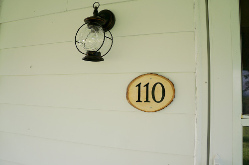 An easy way to create a beautiful plaque for your house. Tutorial at ThinkCrafts.com