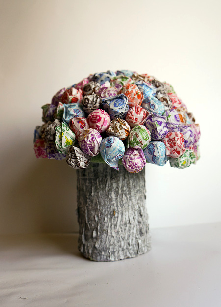 An easy and fun DIY Centerpiece - a mushroom made of lollipops! Tutorial at ThinkCrafts.com