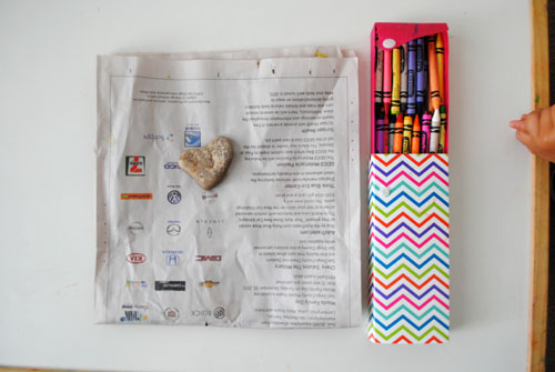 3 - rock on newspaper with crayons