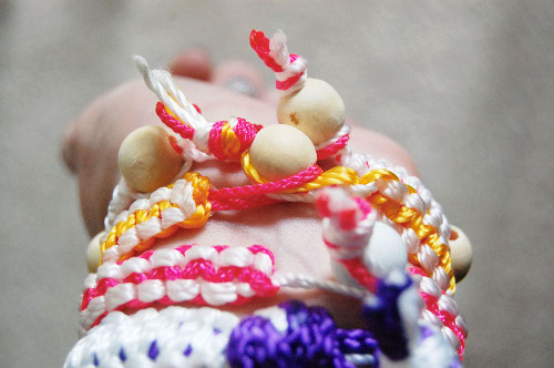 Knotted Bracelets made with neon cord. Tutorial at ThinkCrafts.com