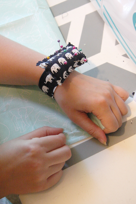 Sew a Wrist Pincushion from scrap fabric! Tutorial at ThinkCrafts.com