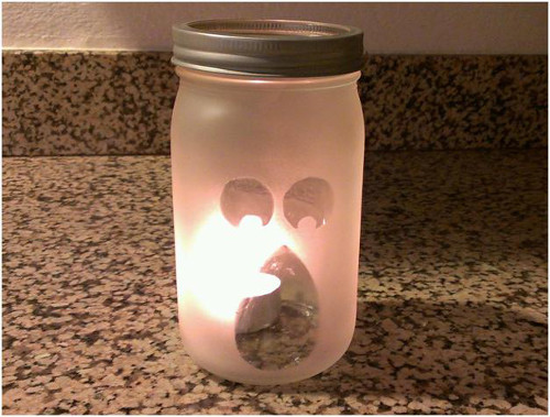 DIY Ghostly Candle Holder for Halloween. Tutorial at ThinkCrafts.com