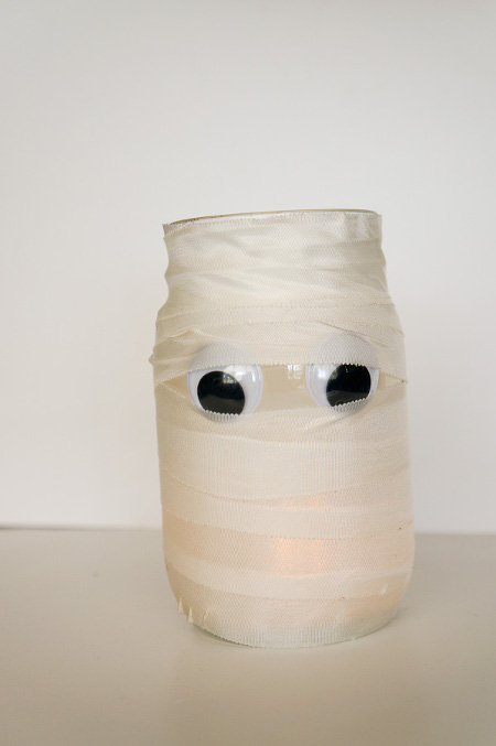 Easy DIY Mummy Candle. Tutorial at ThinkCrafts.com