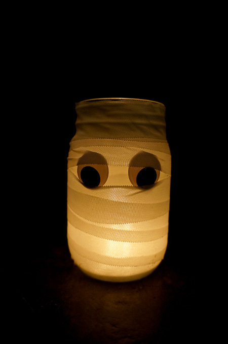 DIY Mummy Candle Holder. Tutorial at ThinkCrafts.com