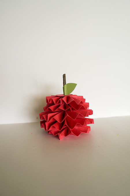 Create this Paper Fan Apple for your teacher! Tutorial at ThinkCrafts.com