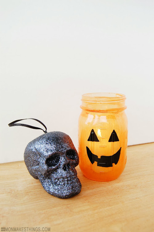 Jack-O-Lantern Jars with Translucent Glass Paint. Tutorial at ThinkCrafts.com