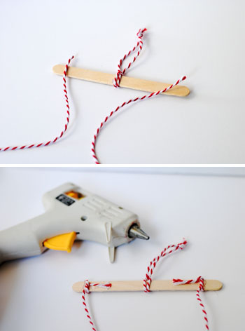 tying bakers twine to popsicle stick