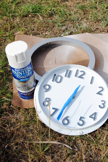 spray painting clock white
