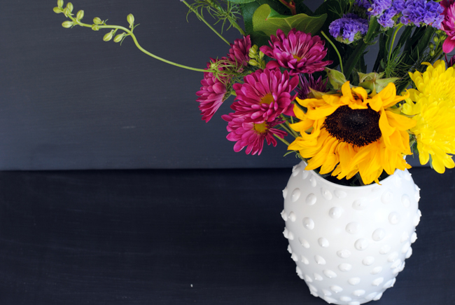 boquet of flowers in hobnail milk glass vase
