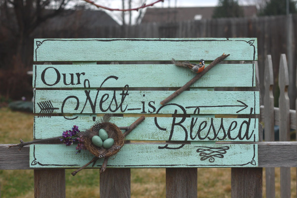 Think spring by creating your own cheerful pallet sign!