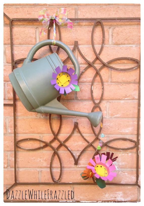Upcycle an old watering can into a pretty decoration for your front door