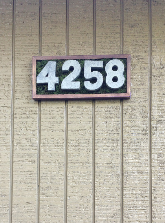 Make a cool and natural looking house number plaque in no time with a fun tutorial on Think Crafts.