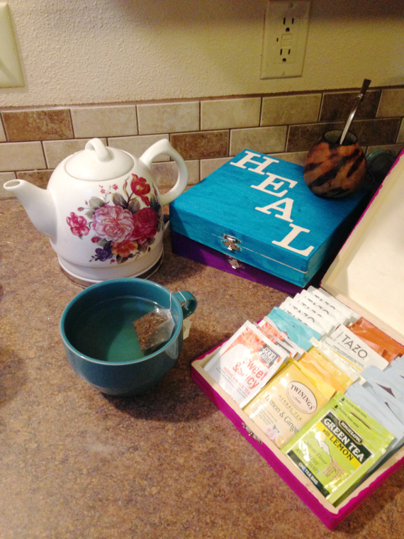 Store all your tea next to your kettle with brightly colored wood boxes!