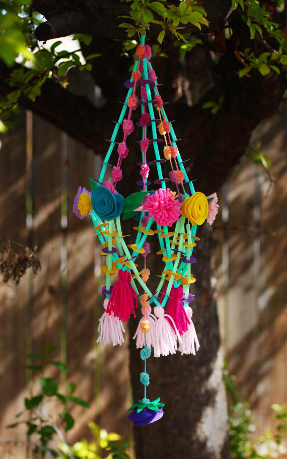 Create a pretty paper chandelier for a spring party or just to brighten up your home on a rainy day.