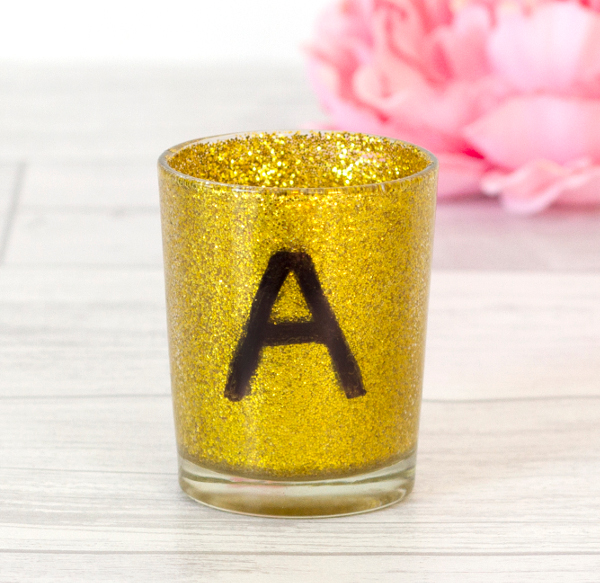 Spell out a name with pretty, personalized candle holders.