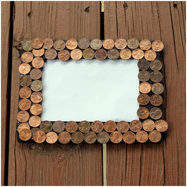 Glue pennies or your Dad's favorite things to a frame for Father's Day! Tutorial at ThinkCrafts.com