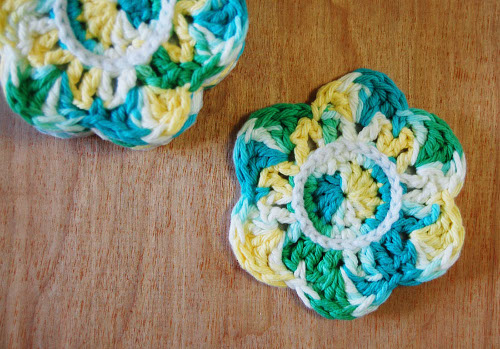Crochet Pattern for cute flower coasters from ThinkCrafts.com