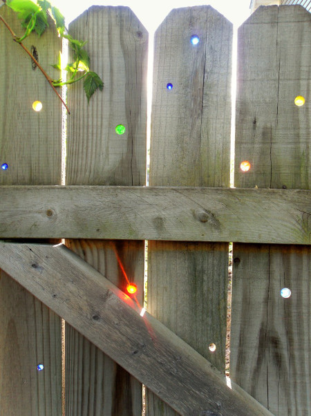 DIY Glass Marbles in Your Fence - Garden Drama