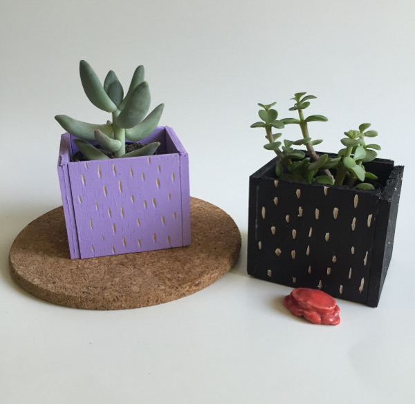 Create a cool painted planter with balsa wood for your fake plants.