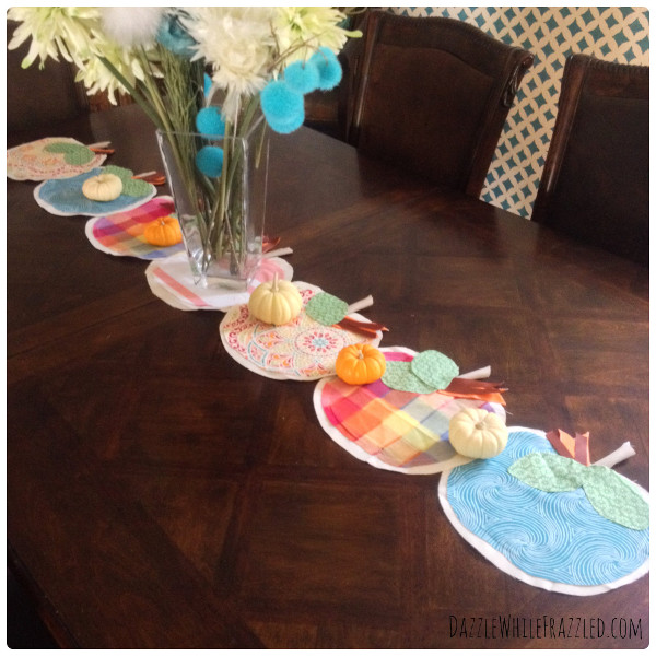 Use up your fall fabric scraps and create a colorful pumpkin table runner
