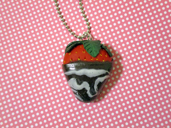 Show off your sweet tooth with a unique polymer clay necklace that looks like a chocolate covered strawberry!