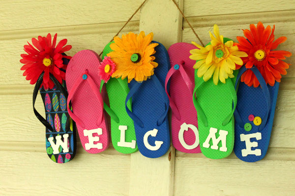 Grab some inexpensive flip flops and create a summery welcome sign for your home.