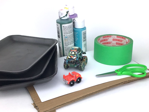 Supplies to make a toy car painting